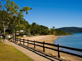 Cannonvale Beach is a favourite with locals for a quiet place to sit, swim, have a barbecue or walk the dog